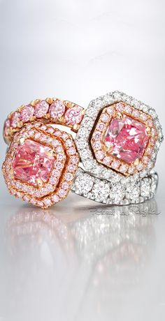 A pair of Pink + White Diamond Rings (=)