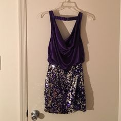 Homecoming dress Royal purple & silver dress. Drapery top front and back and tight silver and purple sequin bottom. Open in back! Very comfortable and only worn once to a homecoming! Open to offers! City Studio Dresses