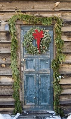 Beautiful old door dressed for Christmas