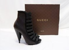 Gucci Cgyz0 1000 Strappy Ankle Open Toe 39.5 Black Boots. Get the must-have boots of this season! These Gucci Cgyz0 1000 Strappy Ankle Open Toe 39.5 Black Boots are a top 10 member favorite on Tradesy. Save on yours before they're sold out!