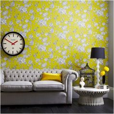 Yellow wall design with rose wallpaper in the living room