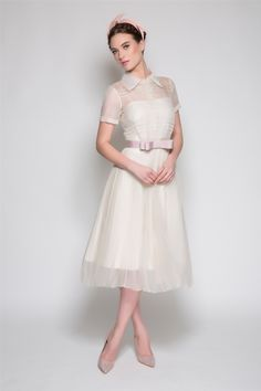 Vintage inspired wedding and event dress. Pleated and sculpted 1950's vibe mid-length shirt style gown in silk organza. Lined in silk habotai. Available in bespoke colours Tailor made to order inclusive of basic fit service..x