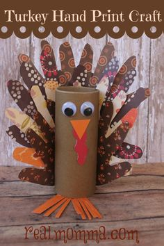 Turkey Hand Print Craft – Thanksgiving Craft with Kids: Love that this version used patterned scrapbook paper!