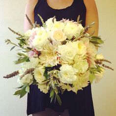 Elegance with rustic charm. White garden roses, lavender, dahlias