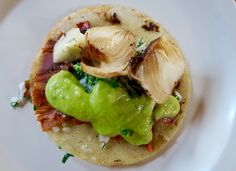 This year, Taco Tuesday coincides with National Taco Day! Here's one of our favorites- pork and onions with limey avocado sauce! Get tasty Latin recipes at susosfork.com