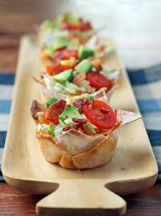 These Turkey Club Wonton Cupcakes are all the flavors you crave from the traditional sandwich, stuffed between layers of wonton wrappers and served warm with a sprinkling of lettuce, tomato, avocado and more bacon! Just 130 calories or 3 Weight Watchers SmartPoints each. www.emilybites.com