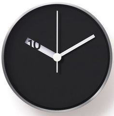 Clean and simple: Extra Normal Wall Clock.At first glance, an elegant, minimal wall clock. But things are not so simple. A subtle effect is taking place, the Extra Normal Wall Clock features a laser-cut opening that revolves around the center, revealing numbers that signify the hours.