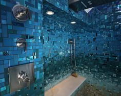 Obsessed with this Caribbean inspired bathroom! Wishing we had an open walk-in shower covered in custom mosaic tile! Blues, teals, turquoises, and sandy floor...like being at the beach! But it's beautiful glass and precious stone tile!