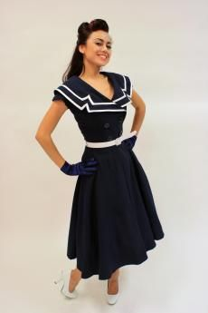 Captain Blue Flare  $160.00  Our most popular dress but look it is in a flare! CAPTAIN FLARE is made out of high quality navy blue stretch bengaline. It is double breasted and has a ruffled sailor collar trimmed with white satin. This is a fitted dress.