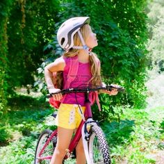 Girl Riding Bicycle Outdoor In Forest Smiling With Helmet ...