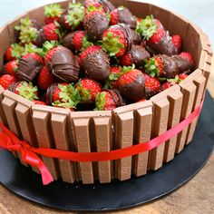 This is the yummiest, tastiest, most amazing chocolate cake recipe EVER! And its decorated with chocolate strawberries and kit kats... what's not to love?