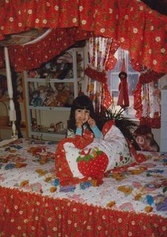 my canopy bed i would still sleep in that exact bed every night if i could get away with it; i loved my strawberry shortcake sheets so much. my parents could never really punish me by sending me to my room, i mean look at it in there!