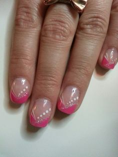 Acrylic nails pink French tip with glitter and white accents
