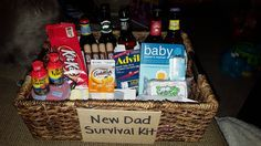 New Dad Survival Kit: snacks, candy, 5-hour energy, beer, cigars, hand sanitizer, advil, boogie wipes, onesie, new dad survival book, baby washcloths -- padded with newborn diapers