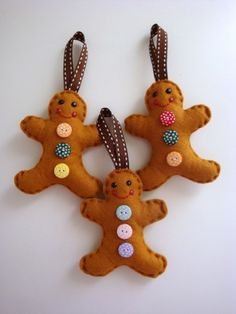 felt gingerbread men decorations...cute.  Gingerbreads are my Christmas theme