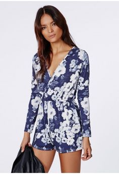 This super cute long sleeved navy floral playsuit is what we are crushin' over at Missguided. With its gathered waistline and wrap neckline this is sure to be mega flattering. Keep it real and team with ankle boots and a leather jacket.  ...