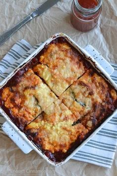Perfect as a side dish or a meatless main dish, this Eggplant Ricotta Casserole is loaded with cheese and absolutely delicious! - Find the recipe on NotEnoughCinnamon.com #glutenfree #cleaneating