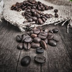 Coffee Beans - Primitivism: use of wooden table and hemp bag identifies cultural cues from before the industrial age Coffee Photos, Coffee Pictures, Coffee Beans, Coffee Cups, Cafe Rico, Mini Desserts, Aeropress Coffee, Fresh Roasted Coffee, Coffee World