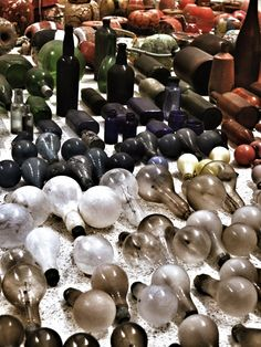 "2012 The Guggenheim Museum presents an installation by Mexican artist Gabriel Orozco titled ""Asterisms"". The show features thousands of objects Orozco collected from the wildlife reserve Isla Arena in Mexico and the Pier 40 playing fields on Manhattan's west side - including glass bottles, lightbulbs, buoys, tools, stones, and oars."