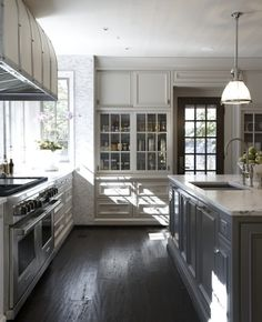 light gray cabinets and carrara.  Rosemary Beach home by Tracery Interiors. Photo by Colleen Duffley. Via Houzz.