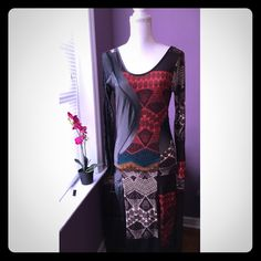 Tribal sexy dress NWOT. Be bold! This dress is great for a night out or maybe on vacation! With the unique tribal print, faux leather side & mesh cut out let a sexy cabana boy fan you, cocktail in hand!  great stretch, two small slits in front & a scoop back, any questions just ask* Dresses