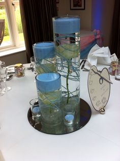 Sunken rose centrepiece in cylinder vase