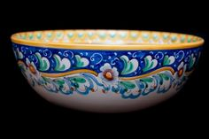 Dinnerware-Touch of Sicily   Salad bowl  The exterior decoration consists of a floral pattern. The internal decoration shows a central rose with soft colours and a band made of waves of yellow, yellow-orange and green ramina