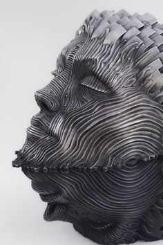 Creative Figure Metal Sculptures Composed of Unraveling Steel