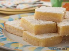 Sunny Lemon Squares - Teach your kids a few tasty skills in the kitchen while having fun baking up these cheery bars.