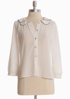 "Shared Memories Blouse In Ivory 34.99 at shopruche.com. Irresistibly sweet, this delicate chiffon blouse in ivory is  perfected with a vintage-styled peter pan collar, front button closures,  and fitted cuffs. Pair with your favorite pencil skirt for a polished  look. Semi-sheer.100% Polyester, Imported, 22"" length from top of shoulders, 35"" bust, All measurements taken from a size small"