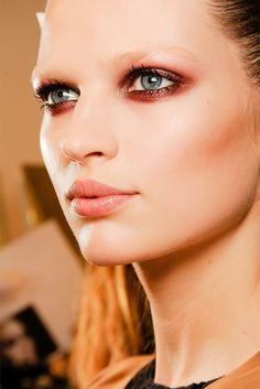 Bette Franke at Gucci f/w 2013 backstage. Edgy smokey eye, soft natural pink lip.