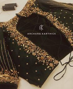 Gorgeous choli blouse for saree or lehenga by Archana Karthick in black with exquisite embroidery in gold. Wedding Saree Blouse Designs, Pattu Saree Blouse Designs, Fancy Blouse Designs, Wedding Blouses, Dress Designs, Hand Work Blouse Design, Stylish Blouse Design, Designer Blouse Patterns, George Bernard