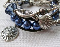 Triple stack of pearl & silver bracelets with sand dollars & shells available at SeaSide Strands.  #coastal # jewlery
