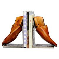 VINTAGE SHOE FORM BOOKENDS|If The Shoe Fits! The best reads tend to be pretty heavy--both in their weight and their subject matter--and when it comes to taming those tremendous tomes with a touch of panache, Breck Armstrong's quirky bookends are just the right fit. Breck's ample, solid iron bookends are soldered with vintage wooden shoehorns that harken to an earlier age, adding an impressive, archival touch to your library.