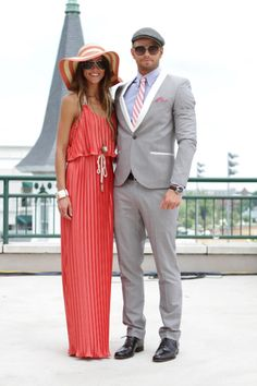 love her dress and hat, of course. the guy is trying to hard (personal opinion).
