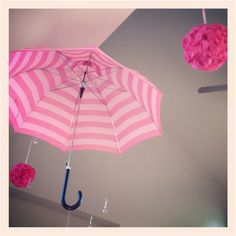 Umbrella hanging with crystals to appear like rain drop as decoration @ VS Pink themed bridal shower-like the raindrop idea