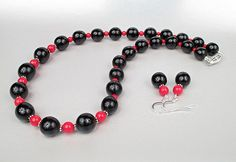 Red coral and black wood beads