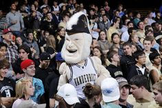 The Vanderbilt Commodores mascot makes sure that the people sitting in the 3 rows behind him won't see a thing. Photo Courtesy: Joe Robbins/Getty Images