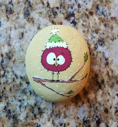 Cute painted rock with tiny red bird.