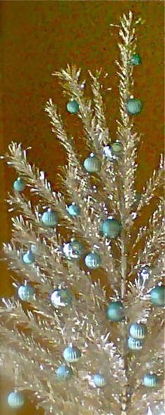 @Alison Hobbs Seery Behan - bemember Papa's BIG silver tinsel Christmas tree... And all the baubles we managed to break every year by accident ...