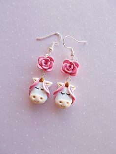 Unicorn dangle earrings created from polymer clay. A cute gift for a unicorn lover or best friends. The earrings lenght is 5 cm , measured with hooks. The charms are completely made out of polymer clay, without using molds of forms. ❀ Price is for one pair of earrings. ❀ I ship the orders in