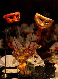 If we can't give everyone masks to wear, we can still use them as centerpieces!!