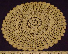 """The outer half of this doily was done in a fan stitch. WillowW - Own work. - a """"fan"""" is two such stitches, followed by a chain and two more such stitches. Fan stitch crochet also differs in that the fans are generally stacked on top of one another, with each fan being done into the middle chain of the fan in the previous row, which splits the previous fan into two symmetrical parts."""