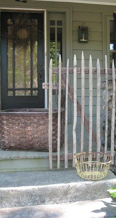 Primitive Porch...handmade twiggy picket, old basket, & wreath.