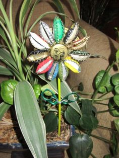 Bottle Cap flower garden stakes. $15.00, via Etsy. http://amzn.to/1q1Dckw