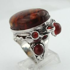 Unique handcrafted Silver Amber Ring. Big statement ring, fits any occasion. Can be worn alone or next to other rings, at both way it will show your unique fashion style. Perfect Gift for your loved one.  ✿✿✿ Details: 925 sterling silver ring with an oval Amber stone in the middle and