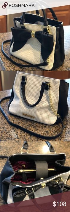 Betsey Johnson Satchel *Very lightly used* black & white Betsey Johnson satchel purse. Features oversized bow, convertible shoulder strap & double top handles. Great condition.   SMOKE FREE / PET FREE HOME  ✨BUNDLE+SAVE✨ Betsey Johnson Bags Satchels