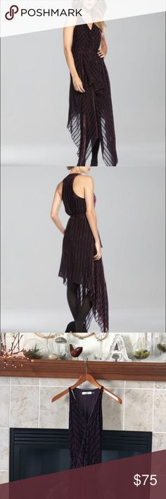 Robert Rodriguez Striped Handkerchief Dress This dress has a handkerchief hem that allows for free-flowing movement. Wine striped semisheer chiffon. V neckline: racetrack. Sleeveless: thin shoulder straps. Skinny wraparound self-tie waist. Rayon/silk. Robert Rodriguez Dresses Asymmetrical