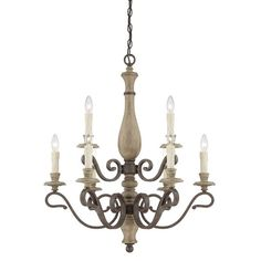 Cast a stylish glow over your dining room or entryway with this handsome chandelier, featuring a turned column and fossil stone finish.   ...