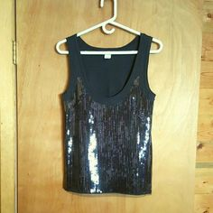 J Crew Charcoal Gray Sequined Tank This almost black tank from J Crew is covered on the front with transparent gray sequins, giving it lots of bling. A touch if feminine tulle along the hemline.  Size Small. 100% cotton except for sequins. J. Crew Tops Tank Tops